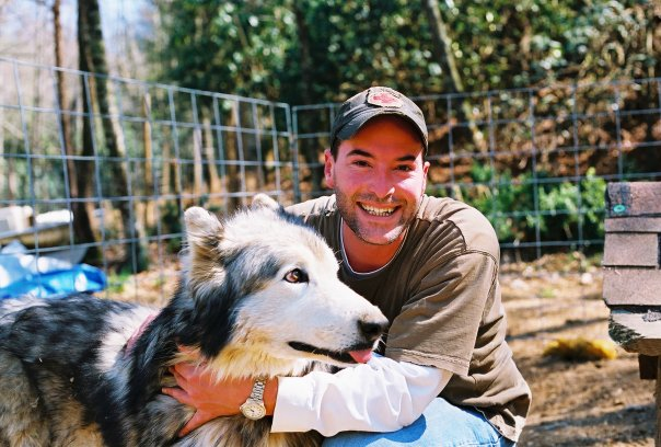 Tim Maddock with Pete, at Full Moon Farm Wolfdog Sanctuary in Black Mountain, NC (2005)