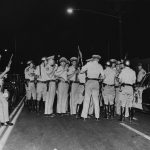 CHP officers with shotguns get ready to man the lines at 112th Street and Avalon Boulevard, during the rioting in the Watts area. Photo courtesy: Los Angeles Public Library