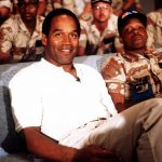 O.J. Simpson in 1990 with a group of servicemen to watch a Thanksgiving Day football game. Simpson is visiting U.S. troops who are in the region for Operation Desert Shield. (Photo: Wikipedia)