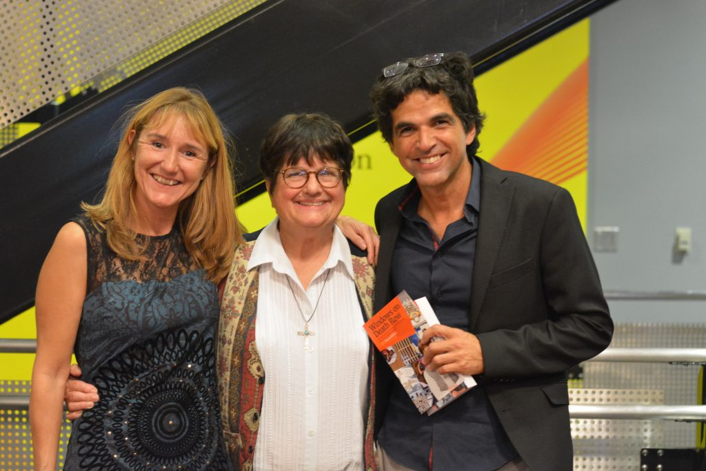 "Anne Widmann, Sister Helen Prejean, and Patrick Chappatte at the opening event for ""Windows on Death Row."""