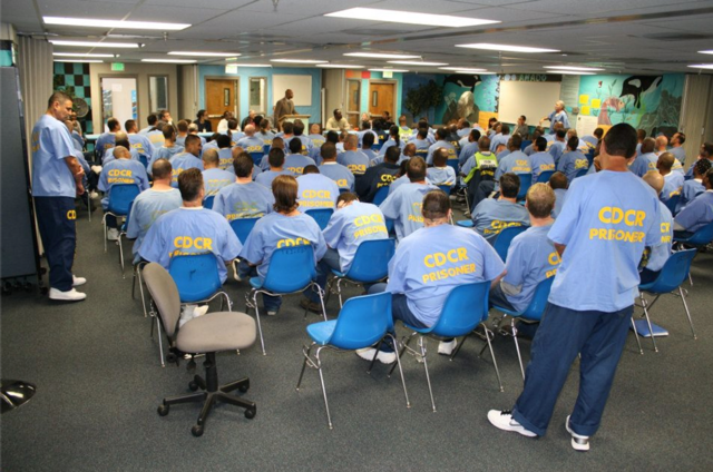 PEP Founder/Director, Dr. Renford Reese speaks to inmates at the California Rehabilitation Center about the Prison Education Project.