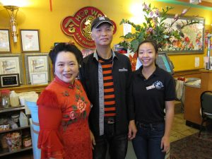 Judy Liang, Lupe Liang and Kelly Liang at Hop Woo Barbecue and Seafood restaurant on Broadway in Chinatown.